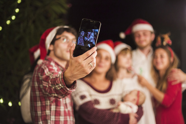 friends-making-selfie-christmas-party_23-2147969531